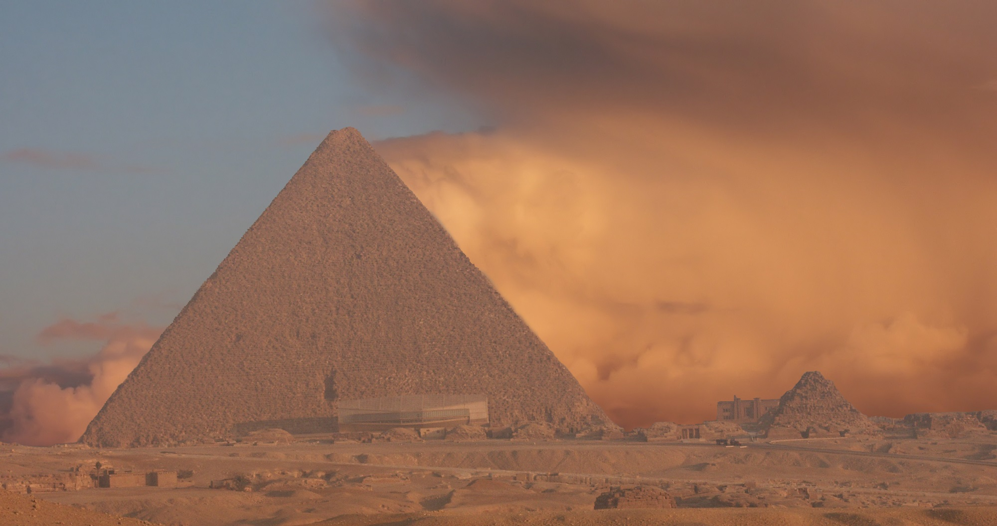 An image of ta sandstorm behind the Great Pyramid of Giza. Shutterstock.