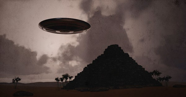 An image of a UFO next to a pyramid. Shutterstock.